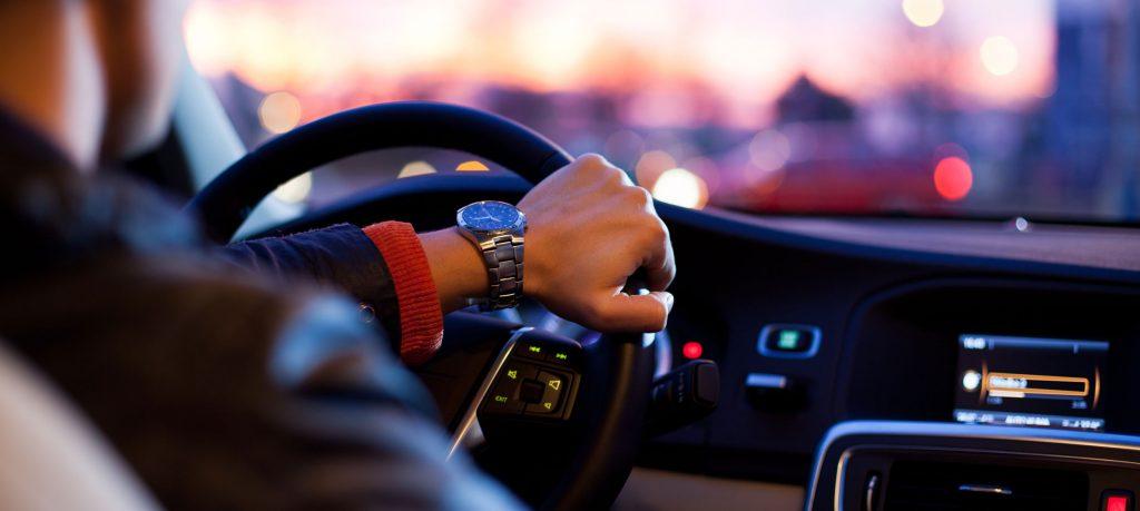 Man driving a car in traffic