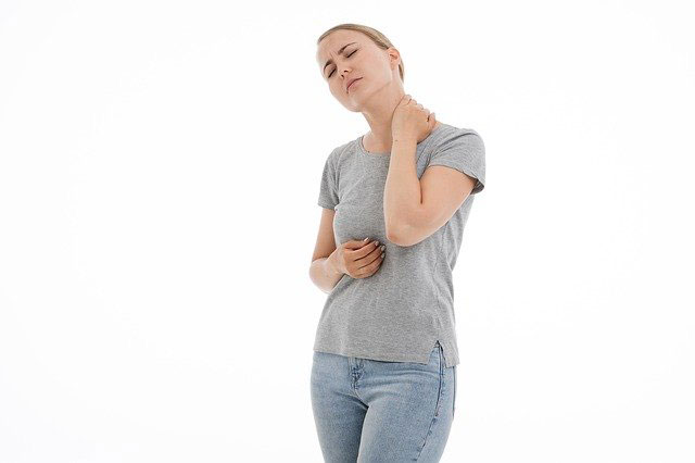 Woman holding her neck in pain.